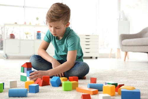 autistic child playing with blocks